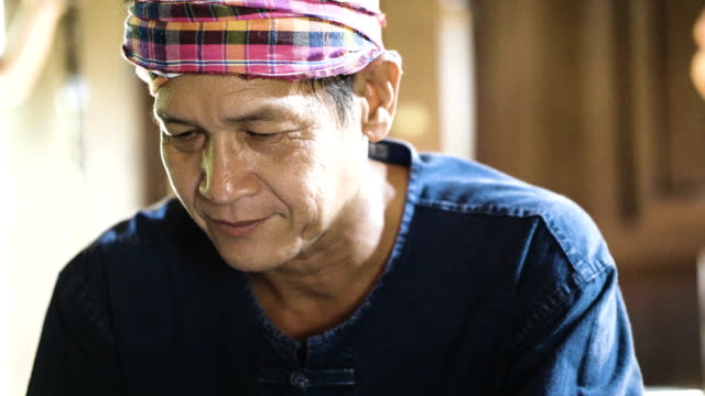 Portrait of asian old man at home Working Seniors myanmar stock videos & royalty-free footage