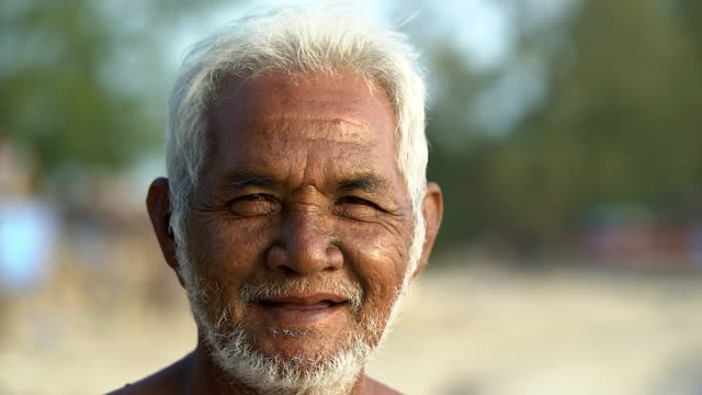 Portrait of asian old man looking at the camera. Portrait of Asian old man looking at the camera. myanmar stock videos & royalty-free footage