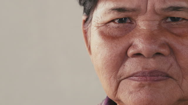 Portrait of asian old, senior, elderly woman looking at camera video