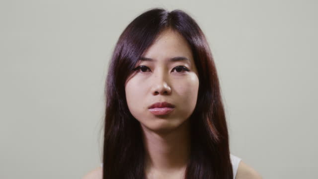 Portrait of asian woman looking at camera, young people emotions video