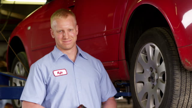 Portrait of auto mechanic video
