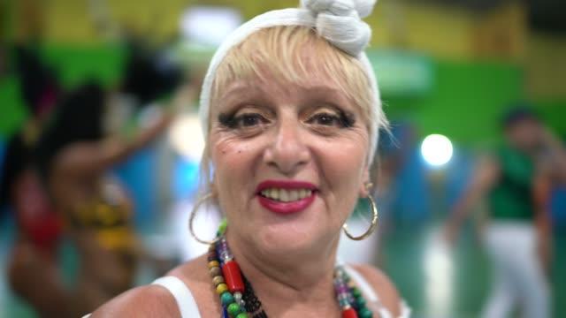 Portrait of baiana (traditional northeast brazilian woman) at carnival school Portrait of baiana (traditional northeast brazilian woman) at carnival school real life stock videos & royalty-free footage