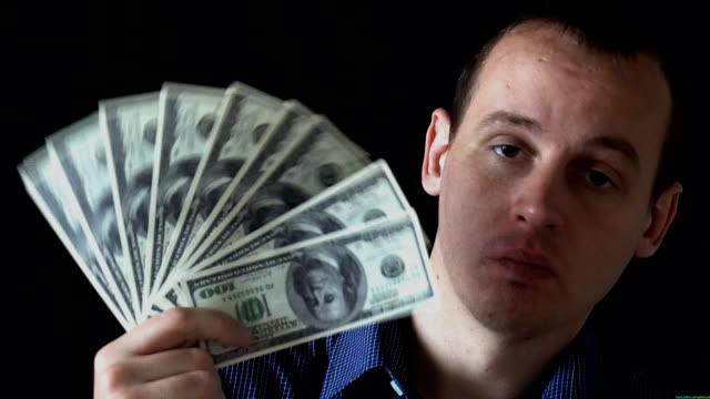 Portrait of Banker Business Man Show dollars Banknotes Money Cash Currency. Black background video