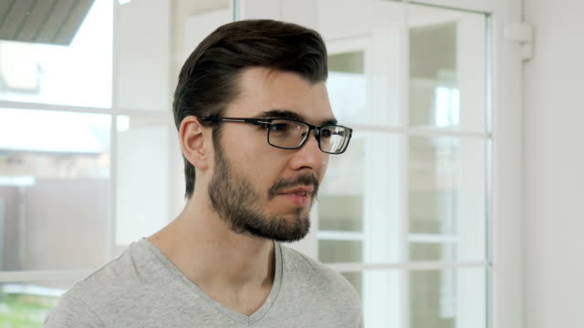 Portrait of bearded guy in eyeglasses video