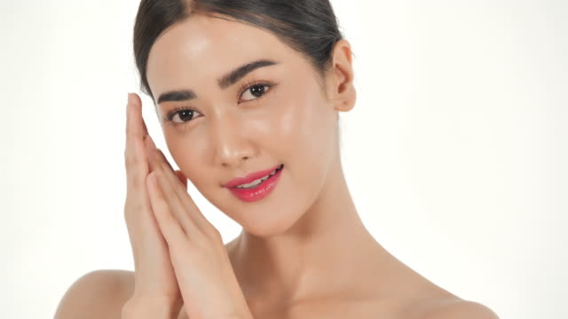 Portrait of beautiful and sexy asian woman on white background.Beautiful woman touching her face with happy emotion.Expressive facial expressions.Cosmetology and Spa.Beauty Face.Video: Diverse Portraits video