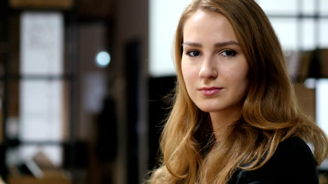 Portrait of Beautiful Girl Sitting Indoor video