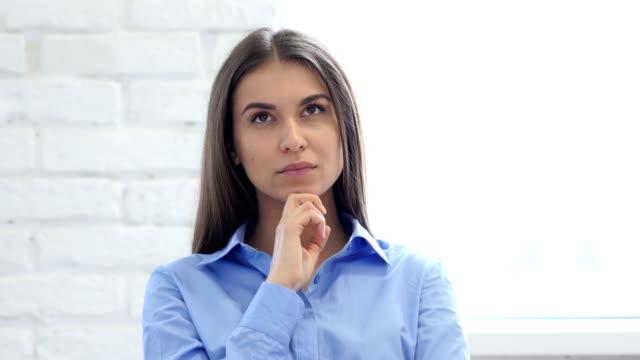 Portrait of Beautiful Thinking Woman Gesturing  Brainstorming video