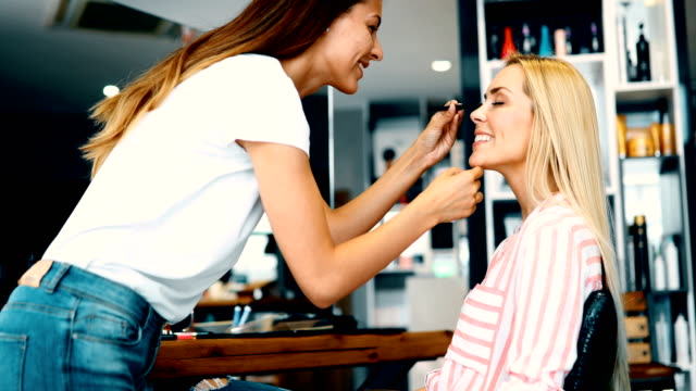 Portrait of beautiful woman getting cosmetic care at beauty salon video
