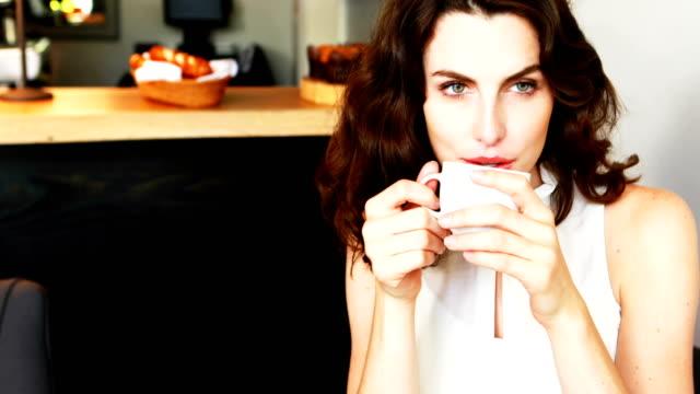Portrait of beautiful woman having coffee video