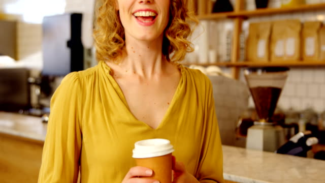 Portrait of beautiful woman offering coffee 4k Portrait of beautiful woman offering coffee at cafe counter 4k saleswoman stock videos & royalty-free footage