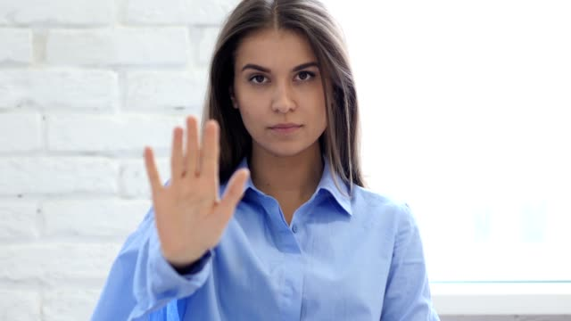Portrait of Beautiful Young Woman Gesturing Stop Sign with Hand video