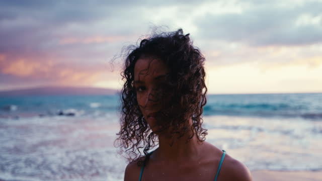 Portrait of beautiful young woman with curly haird blowing in the wind video