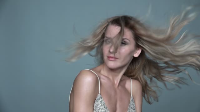 Portrait of beauty young  woman in summer casual dress with shaggy hair video