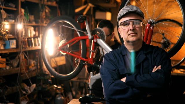 Portrait of Bicycle Mechanic in Workshop