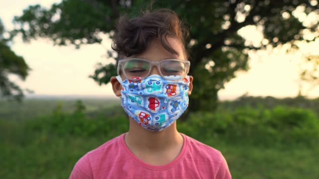 Portrait of boy wearing facial mask Boy, Laughing, Happy, Pandemia, Outdoors mask stock videos & royalty-free footage