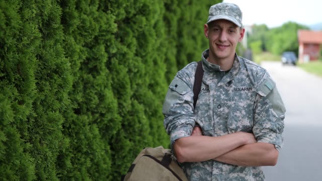 Portrait Of Brave Young Soldier Portrait Of Brave Young Soldier Wearing Uniform camouflage clothing stock videos & royalty-free footage