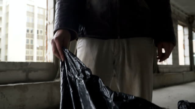 Portrait of bum with garbage bag video