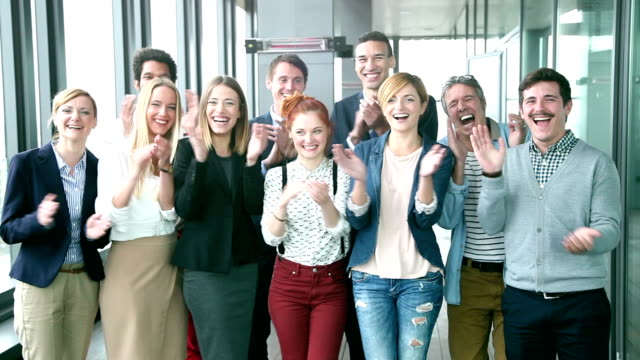Portrait of business and advertising team, laughing and clapping video