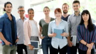 istock Portrait of business people smiling in office 998674234