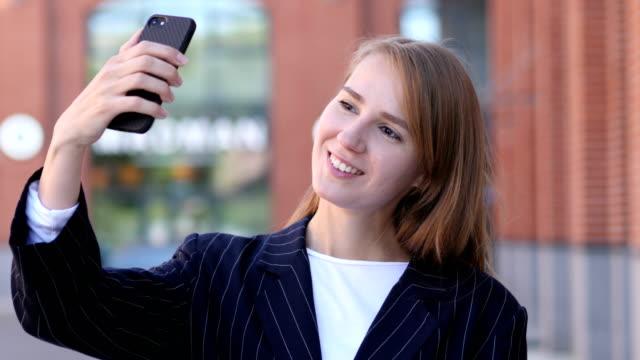 Portrait of Business Woman Taking Selfie on Phone video