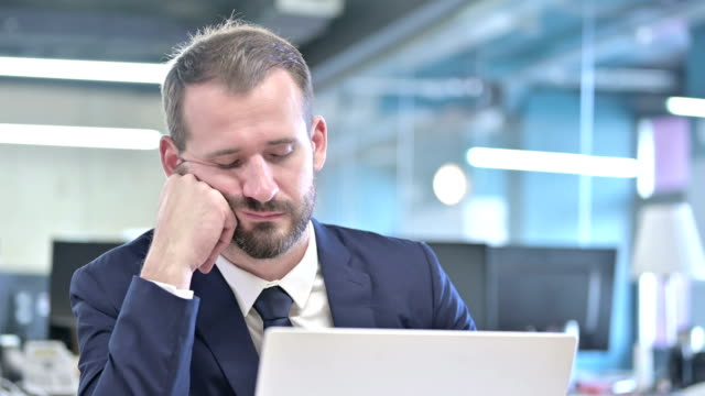 Portrait of Businessman having Quick Nap in Office Portrait of Businessman having Quick Nap in Office yawning stock videos & royalty-free footage