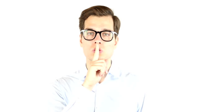 Portrait of businessman making silence gesture , isolated white background video