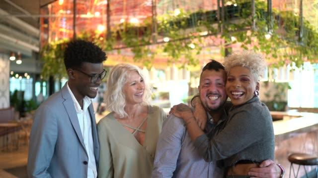 Portrait of businesspeople embracing together - Teamwork