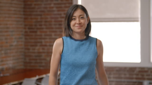 Portrait Of Businesswoman In Office Shot In Slow Motion video