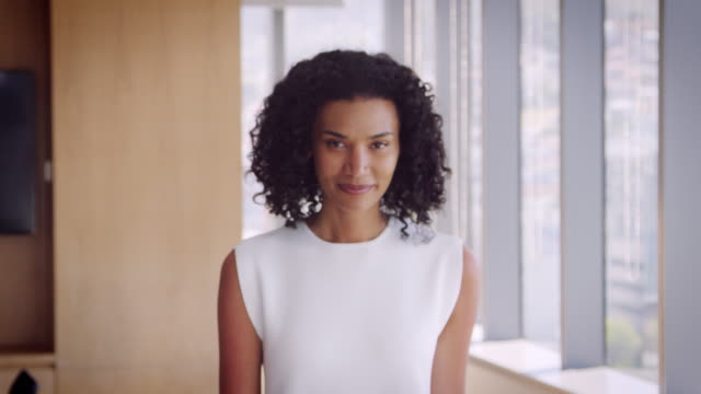 Portrait Of Businesswoman In Office Walking Towards Camera - video