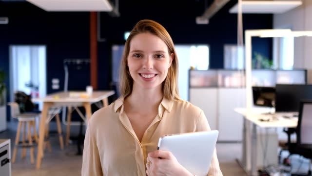 Portrait of businesswoman smiling in office