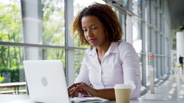 Portrait Of Businesswoman Working On Laptop In Modern Office video