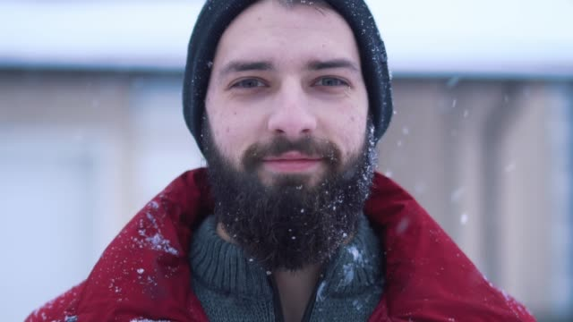 portrait of calm bearded man looking in camera close-up. - baffo peluria del viso video stock e b–roll