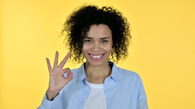 Portrait of Cheerful Casual African Woman doing OK Sign