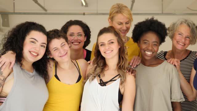 portrait of cheerful females in fitness class - body positive video stock e b–roll