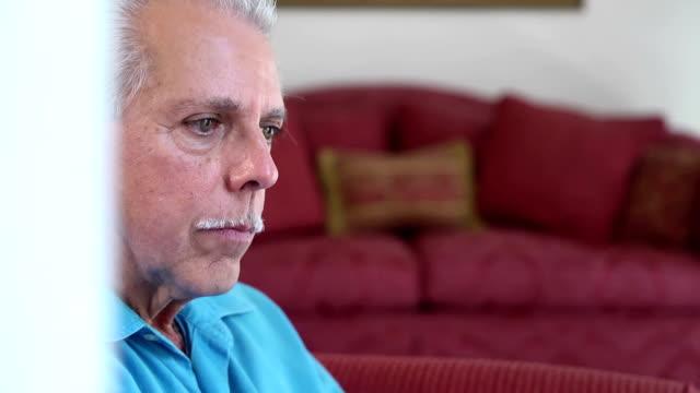 Portrait of Concern Senior Latin Man video