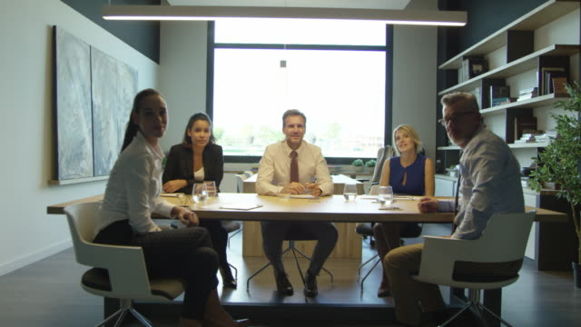 portrait of confident businesspeople in board room - dolly shot video stock e b–roll