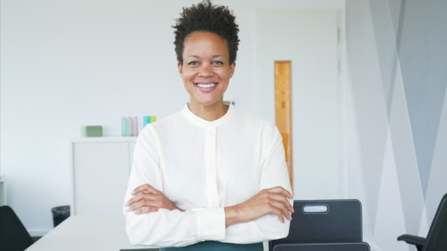 portrait of confident businesswoman in her office. - direttrice video stock e b–roll
