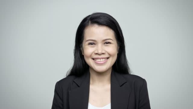 Video Portrait of confident female executive smiling