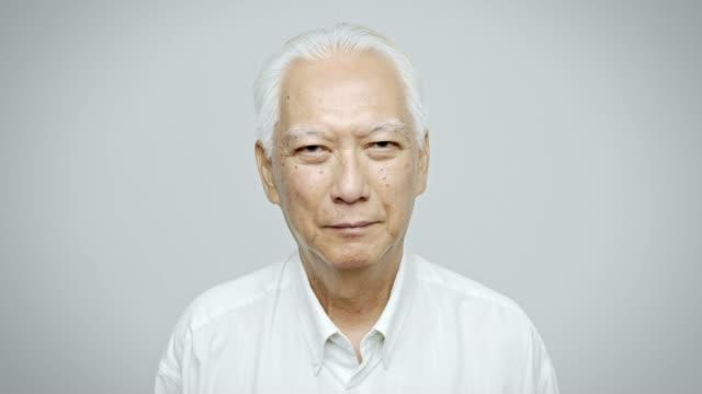 portrait of confident senior businessman in shirt - sfondo bianco video stock e b–roll