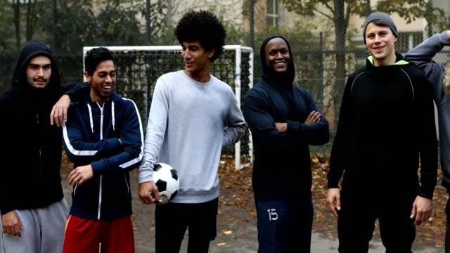 portrait of confident soccer team - fianco a fianco video stock e b–roll
