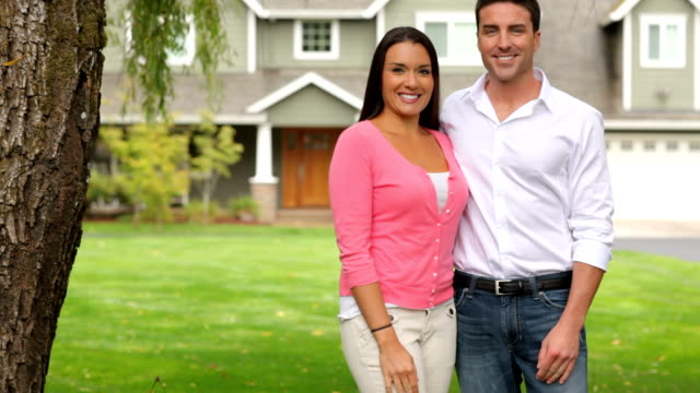 Portrait of couple by new home video