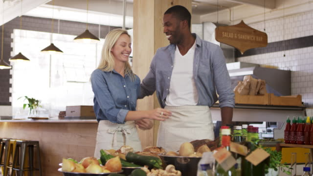Portrait Of Couple Running Organic Delicatessen Together video