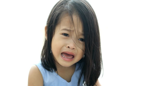 Portrait of crying little asian girl in the house video