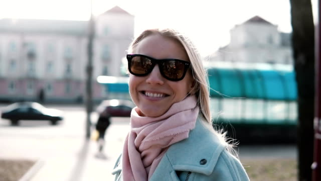Portrait of cute Caucasian girl smiling at camera. Cheerful happy 20s lady laughing slow motion. Joy happiness concept video