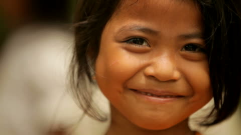 Portrait of cute girl smiling happily  childhood stock videos & royalty-free footage