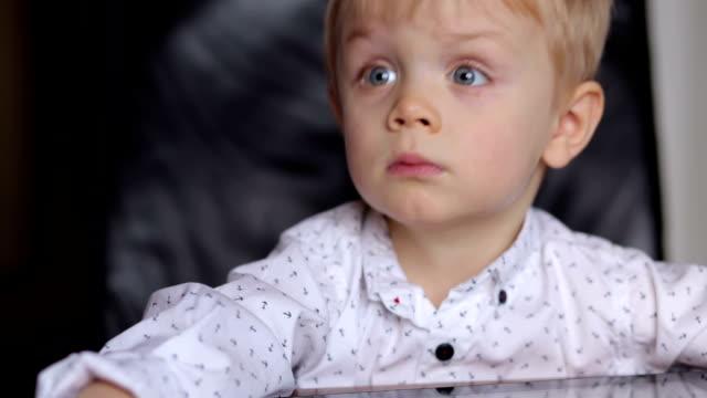 Portrait of cute little boy with blue eyes. video
