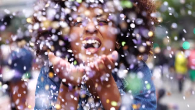 portrait of cute woman blowing confetti - celebration stock videos & royalty-free footage
