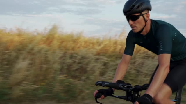 portrait of cyclist man training on road bike. - triatleta video stock e b–roll
