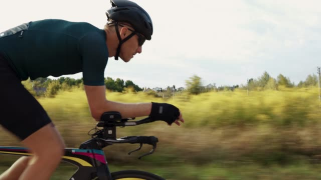 portrait of cyclist man training on road bike. - ciclismo su strada video stock e b–roll