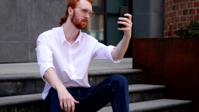 Portrait of Designer Taking Selfie on Phone video